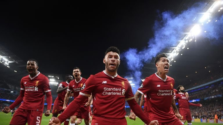 Alex Oxlade-Chamberlain leads the celebrations after Liverpool's first goal against Manchester City